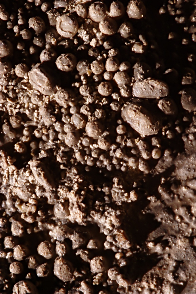 high-contrast image of cave pearls lit by a single hard light source